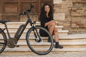 Titania ebike with girl on steps by Powabyke Electric Bikes