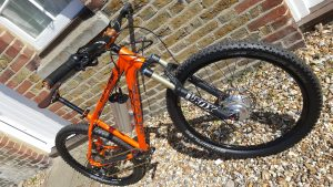 Whtye Bike MTB fitted with a disk brake compatible conv-e motor