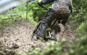 Muddy cyclist covered in mud